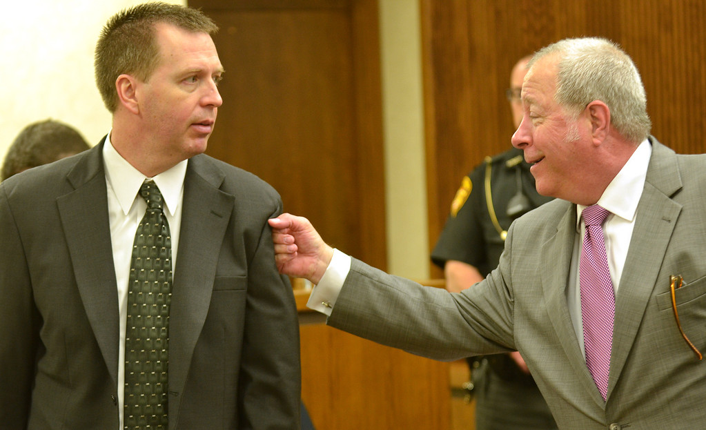 . Michael Allen Blair/MBlair@News-Herald.com Kevin Knoefel, left, gets a playful punch in the arm by his defense attorney Michael J. Connick after the close of the first day of testimony for Knoefel\'s conspiracy trial in Lake County Common Pleas Court on  June 2, 2014.