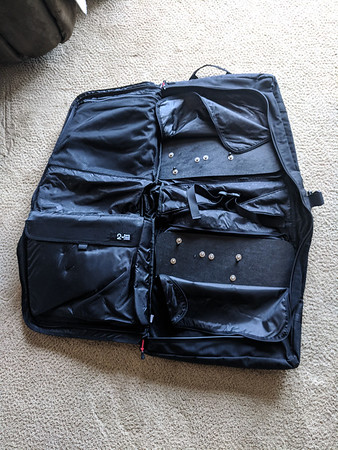 Once yo open it completely, you see several pockets on the inside with a padded laptop sleeve (bottom left) a large mesh pocket and two small ones and a couple of straps.