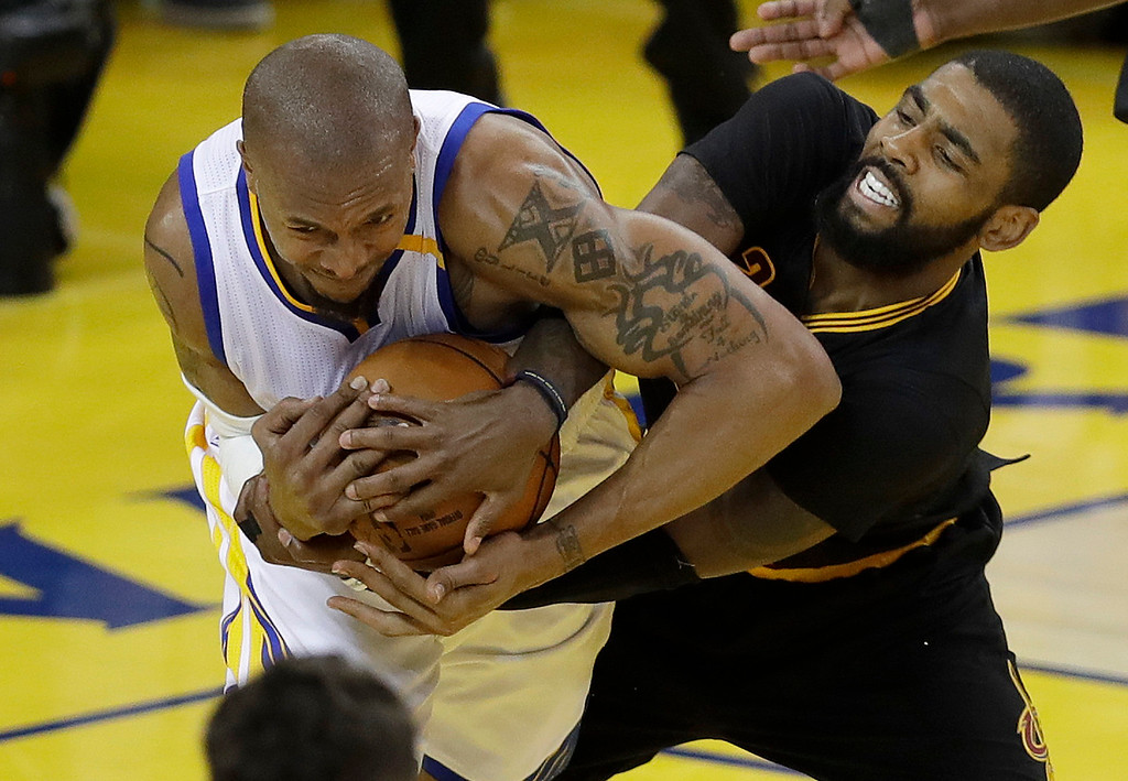 . Golden State Warriors forward David West, left, wrestles for the ball with Cleveland Cavaliers guard Kyrie Irving during the first half of Game 5 of basketball\'s NBA Finals in Oakland, Calif., Monday, June 12, 2017. (AP Photo/Marcio Jose Sanchez)