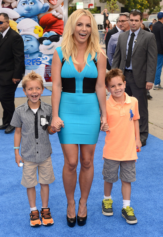 """. Singer Britney Spears, center, and her sons Sean Federline and Jayden James Federline  arrive at the world premiere of \""""The Smurfs 2\"""" at the Regency Village Theatre on Sunday, July 28, 2013 in Los Angeles. (Photo by Jordan Strauss/Invision/AP)"""