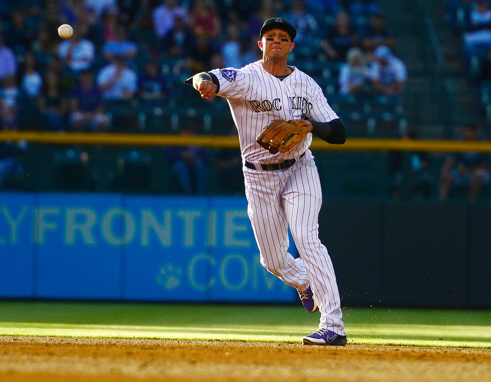 . DENVER, CO - MAY 21: Troy Tulowitzki (2) of the Colorado Rockies makes a play against the Arizona Diamondbacks during action at Coors Field. The Arizona Diamondbacks visited the Colorado Rockies. (Photo by AAron Ontiveroz/The Denver Post)