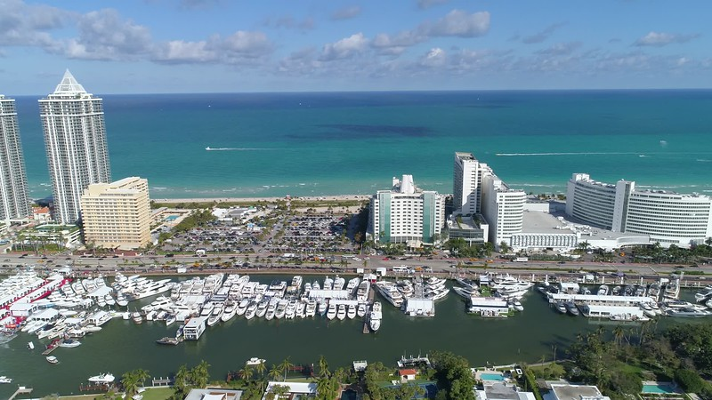 Aerial miami video mansions yachts hotels and Atlantic Ocean 4k