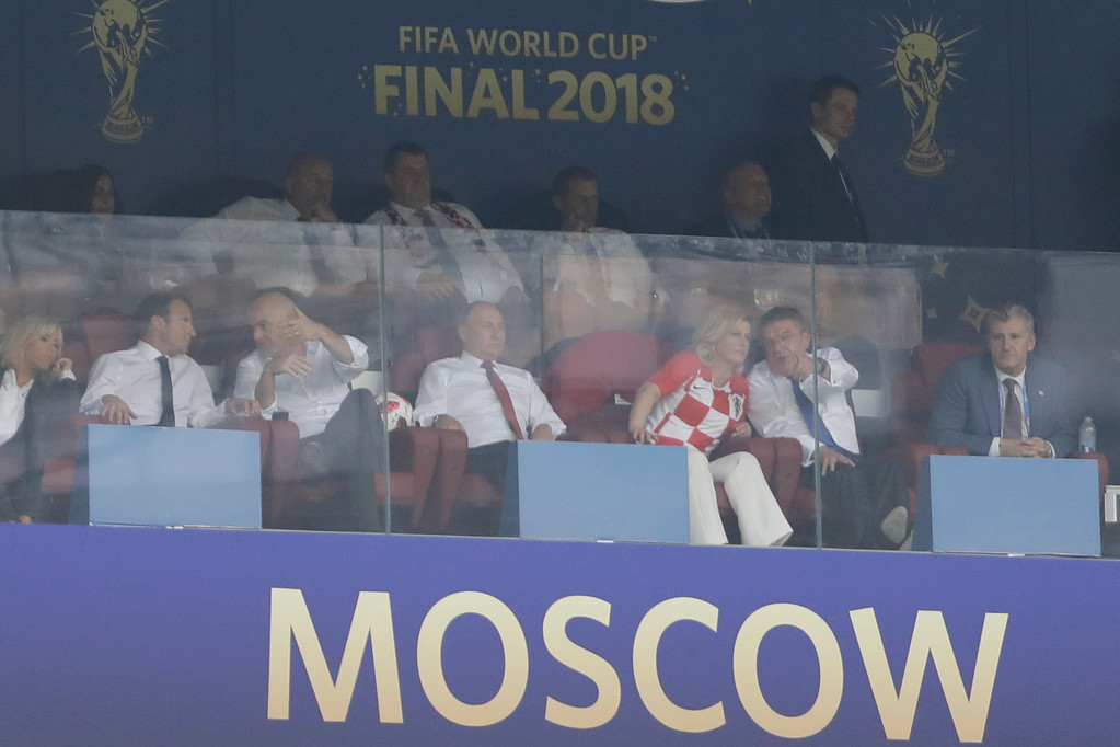 . From left to right, France\'s President Emmanuel Macron, FIFA President Giovanni Infantino, Russia\'s President Vladimir Putin and Croatia\'s President Kolinda Grabar-Kitarovic watch the final match between France and Croatia at the 2018 soccer World Cup in the Luzhniki Stadium in Moscow, Russia, Sunday, July 15, 2018. (AP Photo/Natacha Pisarenko)