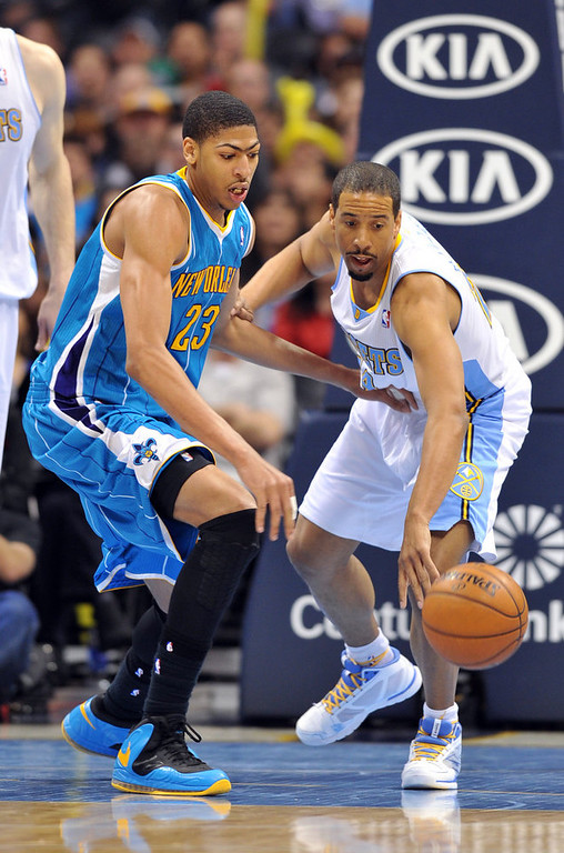 . DENVER, CO. - FEBRUARY 01: Andre Miller of Denver Nuggets #24 steals the ball from Anthony Davis of New Orleans Hornets #23 in the 2nd half of the game on February 1, 2013 at the Pepsi Center in Denver, Colorado. Denver won 113-98. (Photo By Hyoung Chang/The Denver Post)