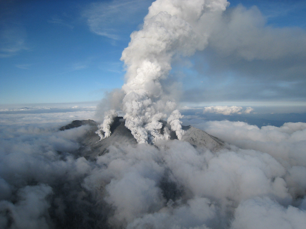 . This handout picture taken by Ministry of Land, Infrastructure and Transport Chubu Regional Development Bureau on September 27, 2014 shows white smoke rising from Mount Ontake as Japan\'s volcano Ontake erupts in Nagano prefecture, central Japan.  Dozens of hikers were stranded on the slopes of an erupting Japanese volcano that has reportedly killed one person and left 30 more seriously injured. The eruption of the 3,067-meter Mount Ontake straddling Nagano and Gifu prefecture happened around midday.   AFP PHOTO / MINISTRY OF LAND, INFRASTRUCTURE AND TRANSPORT CHUBU REGIONAL DEVELOPMENT BUREAU via JIJI PRESS