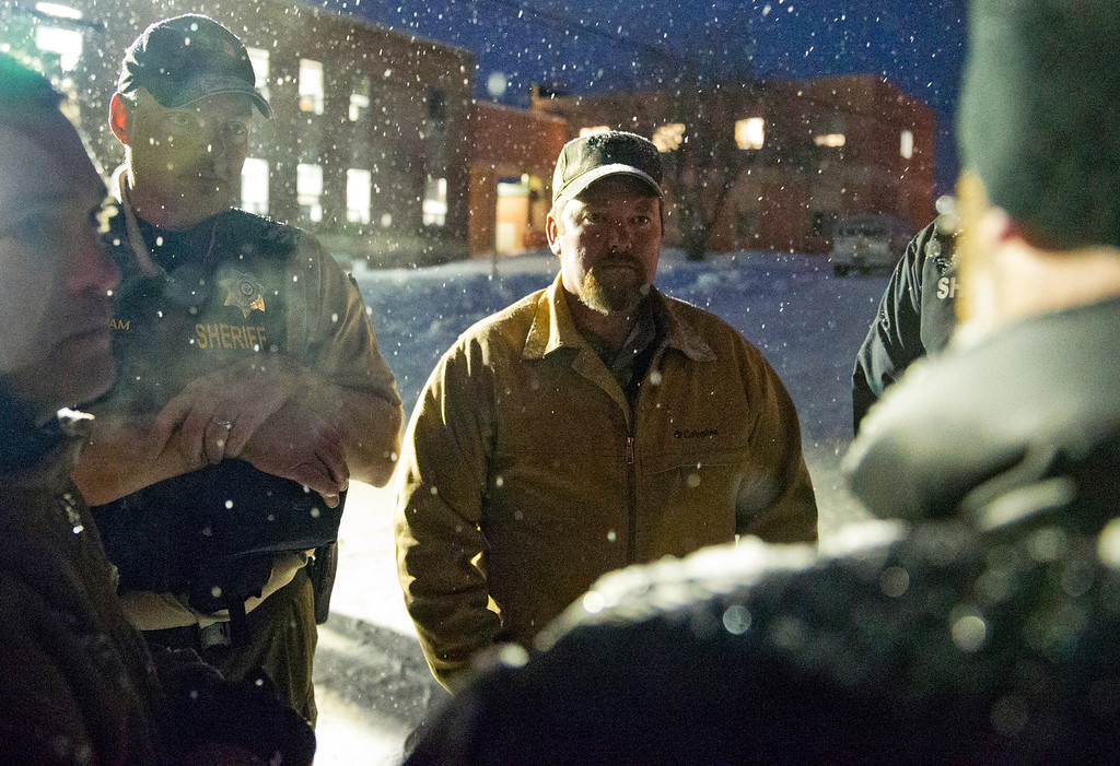 """. Members of \""""the Idaho 3%\"""" and the group\'s president, Brandon Curtiss, meet with Sheriff Dave Ward outside of the Harney County Courthouse on Saturday, Jan 9, 2016 in Burns, Ore.  A small, armed group has been occupying a remote national wildlife refuge in Oregon for a week to protest federal land use policies.  (Dave Killen/The Oregonian via AP) MAGS OUT; TV OUT; NO LOCAL INTERNET; THE MERCURY OUT; WILLAMETTE WEEK OUT; PAMPLIN MEDIA GROUP OUT; MANDATORY CREDIT"""
