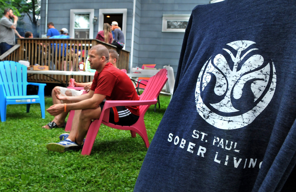 . A St. Paul Sober Living T-shirt is draped over a chair at a barbecue for residents, staff, friends, family and sponsors of St. Paul Sober Living.  (Pioneer Press: Jean Pieri)