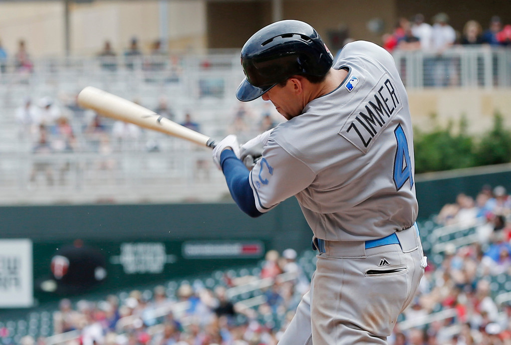 . Cleveland Indians\' Bradley Zimmer follows through as he grounds into an RBI fielder\'s choice off Minnesota Twins relief pitcher Buddy Boshers in the sixth inning during the first game of a baseball doubleheader Saturday, June 17, 2017, in Minneapolis. (AP Photo/Jim Mone)