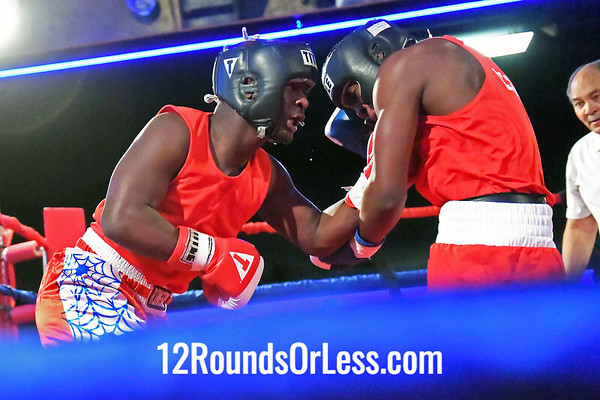 Bout #5:  Dante Benjamin, Blue Gloves, MLK BC, Cleveland, OH   vs   Romello Webb, Red Gloves, Christamore House BC, Indianapolis, IN,  178 Lbs.