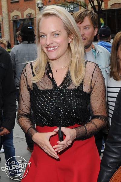 Elisabeth Moss Shows Off Her Legs in Short Red Skirt & See Through Sheer Top