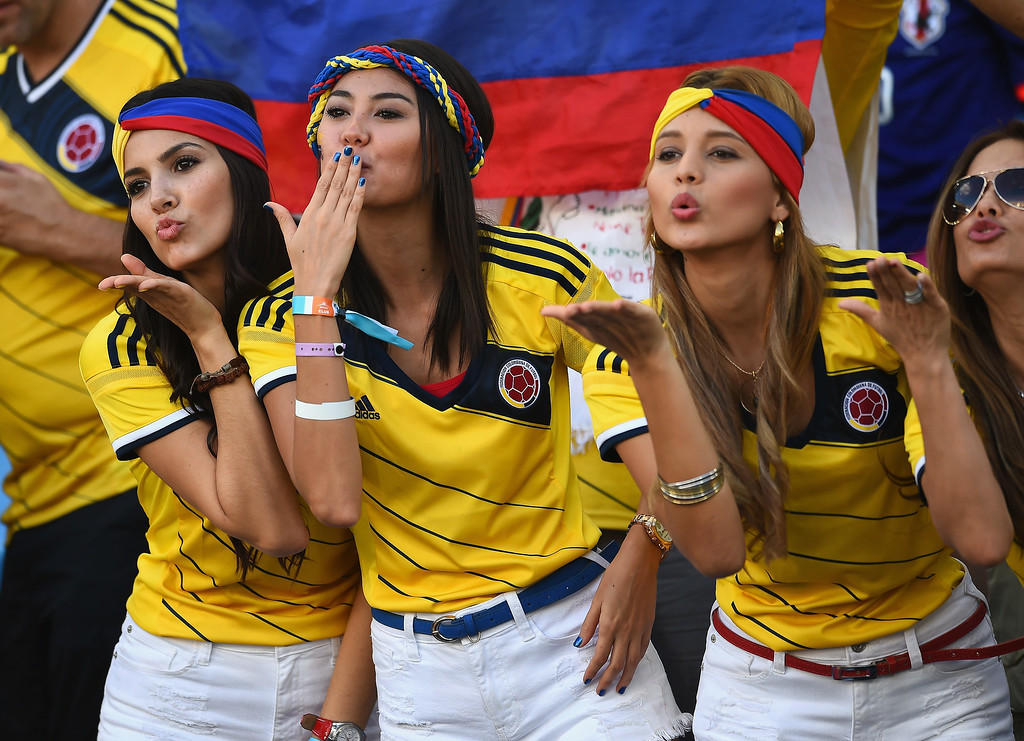 . Colombia fans blow kisses during the 2014 FIFA World Cup Brazil Group C match between Japan and Colombia at Arena Pantanal on June 24, 2014 in Cuiaba, Brazil.  (Photo by Christopher Lee/Getty Images)
