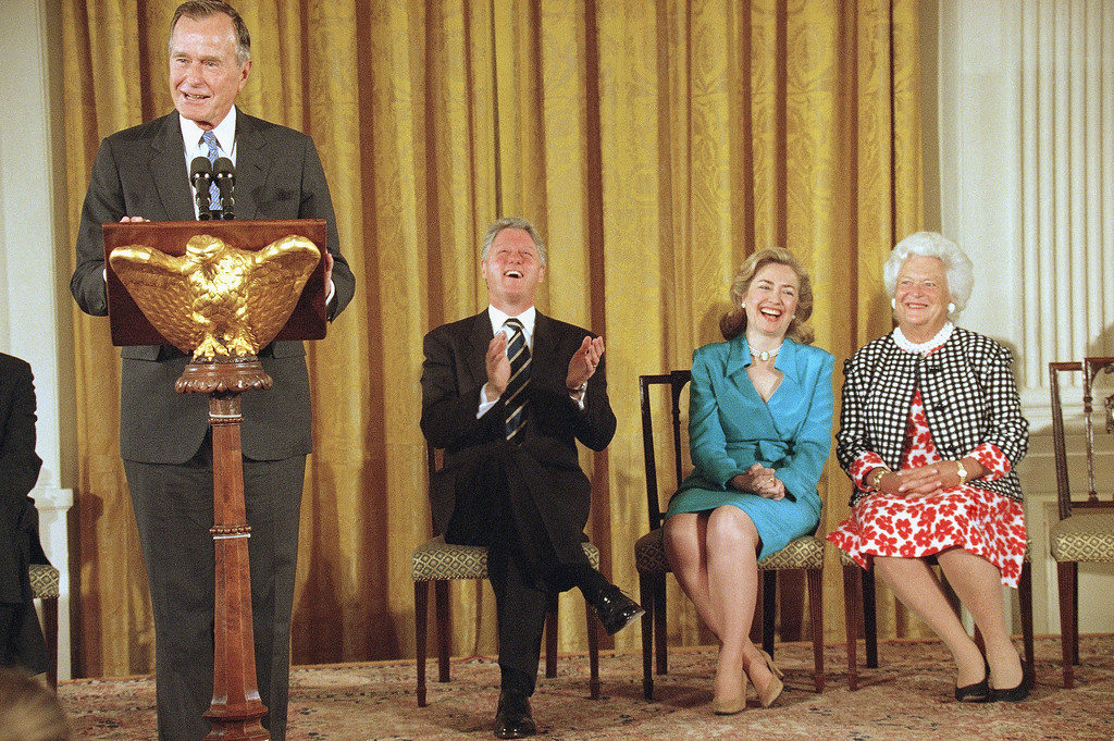 """. President Bill Clinton, first lady Hillary Rodham Clinton and former first lady Barbara Bush laugh as former President George Bush speaks in the East Room of the White House on Monday, July 17, 1995, where his and Mrs. Bush\'s official portraits were unveiled. Bush said of his portrait """"I\'m inclined to think it\'s pretty darn good.\'\'  Both portraits were painted by Herbert E. Abrams of Warren, Conn. (AP Photo/Wilfredo Lee)"""
