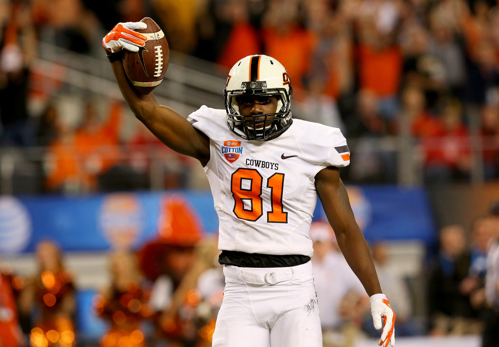 . ARLINGTON, TX - JANUARY 03:  Jhajuan Seales #81 of the Oklahoma State Cowboys celebrates a 21-yard touchdown in the third quarter against the Missouri Tigers during the AT&T Cotton Bowl on January 3, 2014 in Arlington, Texas.  (Photo by Ronald Martinez/Getty Images)