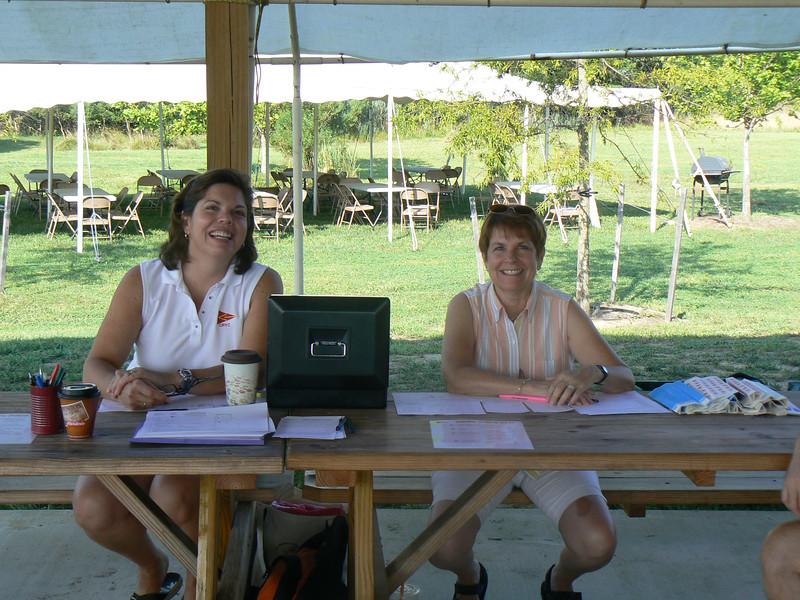Mary and Dana sitting sentinal at registration.