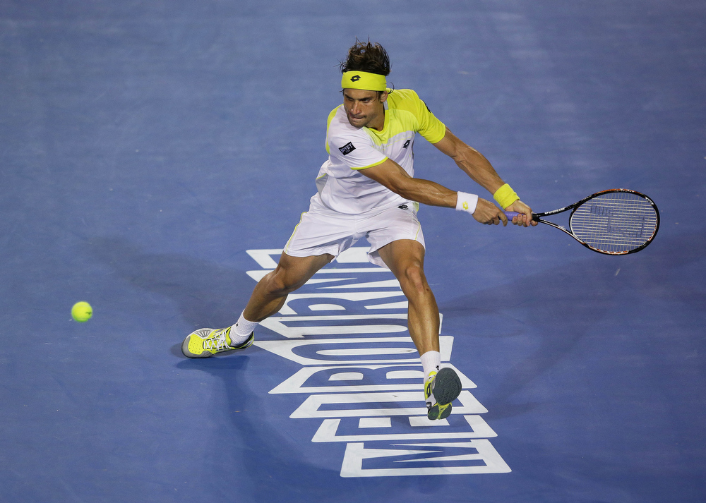 Description of . Spain's David Ferrer hits a return to Serbia's Novak Djokovic during their semifinal match at the Australian Open tennis championship in Melbourne, Australia, Thursday, Jan. 24, 2013. (AP Photo/Aaron Favila)