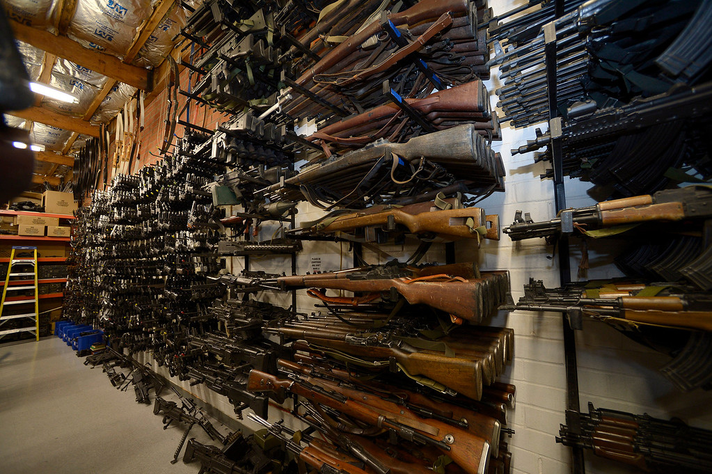 . Fake weapons line a wall at ISS. Gregg Bilson, Jr. is the CEO of ISS Independent Studio Services, a prop house that holds hundreds of thousands of items used for motion pictures and television production. Runaway production has an impact on his business. Sunland, CA 12-31-2013. photo by (John McCoy/Los Angeles Daily News)