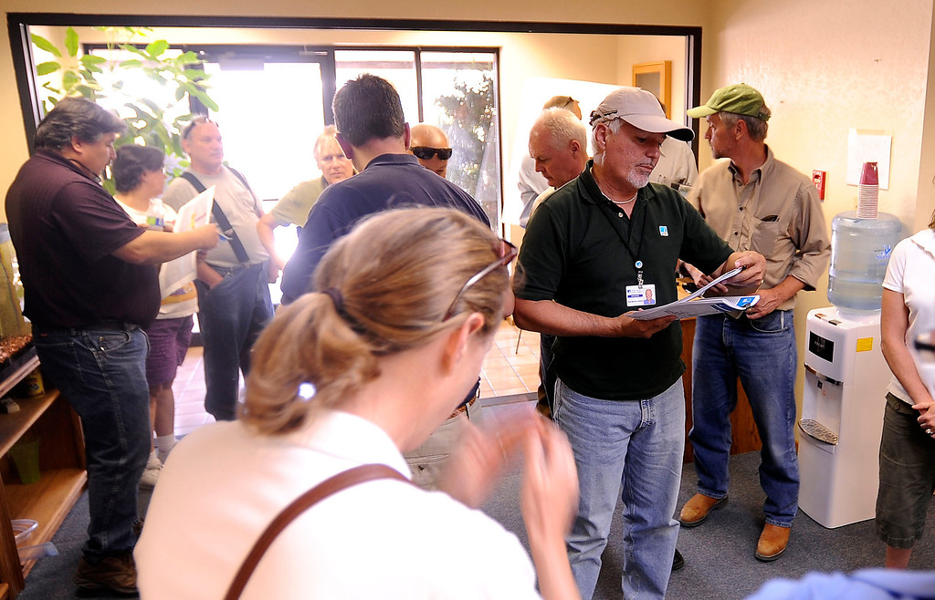 . Members of the Lahontan Regional Water Quality Control Board and members of the community prepare to take a PG&E tour to learn more about a Whole House Water system in Hinkley June 13, 2012.  GABRIEL LUIS ACOSTA/STAFF PHOTOGRAPHER.