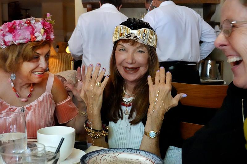 (L-R) Ludmila Kisseleva-Eggleton, Sheila Ash showing birthday bracelet gift to Luda, Eva Strauss-Rosen