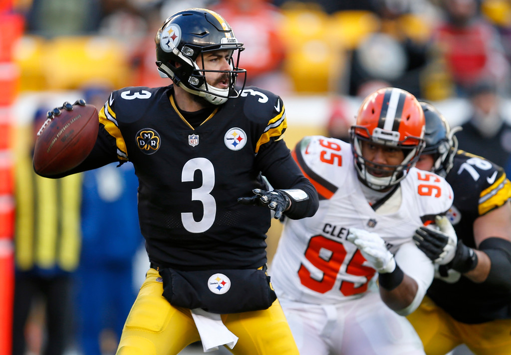 . Pittsburgh Steelers quarterback Landry Jones (3) looks to pass under pressure from Cleveland Browns defensive end Myles Garrett (95) during the second half of an NFL football game in Pittsburgh, Sunday, Dec. 31, 2017. (AP Photo/Keith Srakocic)