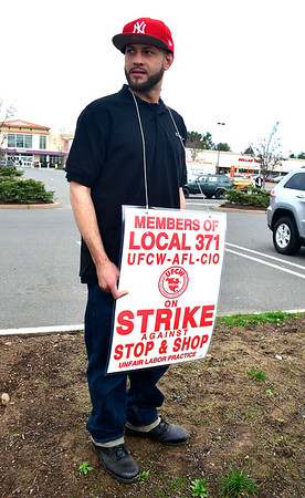 4/11/2019 Mike Orazzi | Staff Striking Stop & Shop worker Antonio Padilla at the grocery store on Route 6 in Bristol on Thursday.