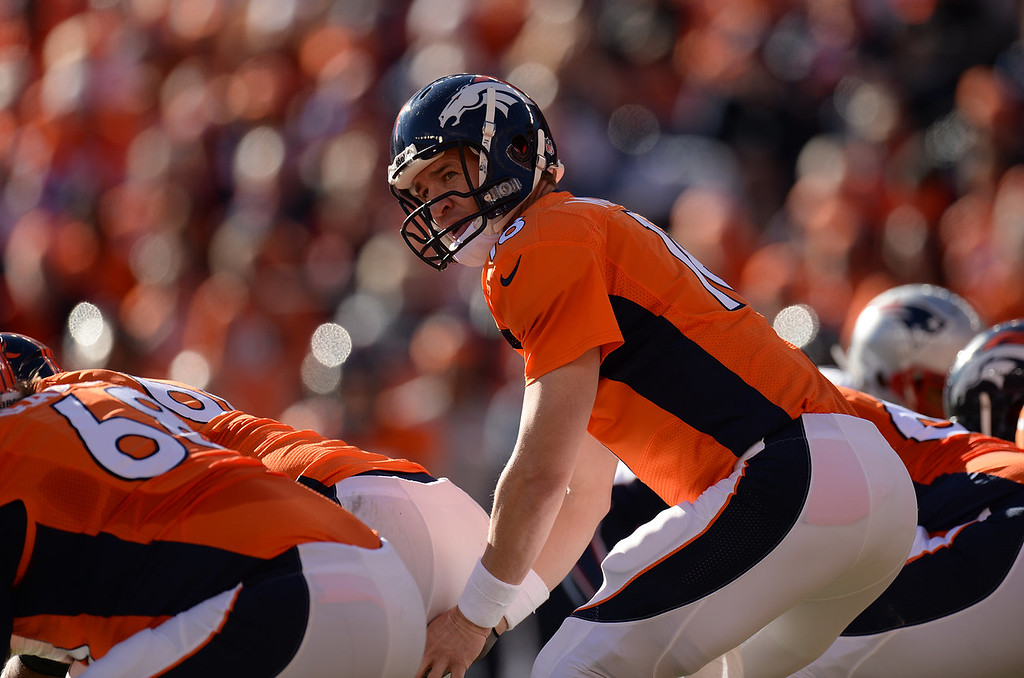 . Denver Broncos quarterback Peyton Manning (18) waits for the snap at the line in the second quarter. The Denver Broncos take on the New England Patriots in the AFC Championship game at Sports Authority Field at Mile High in Denver on January 19, 2014. (Photo by Hyoung Chang/The Denver Post)