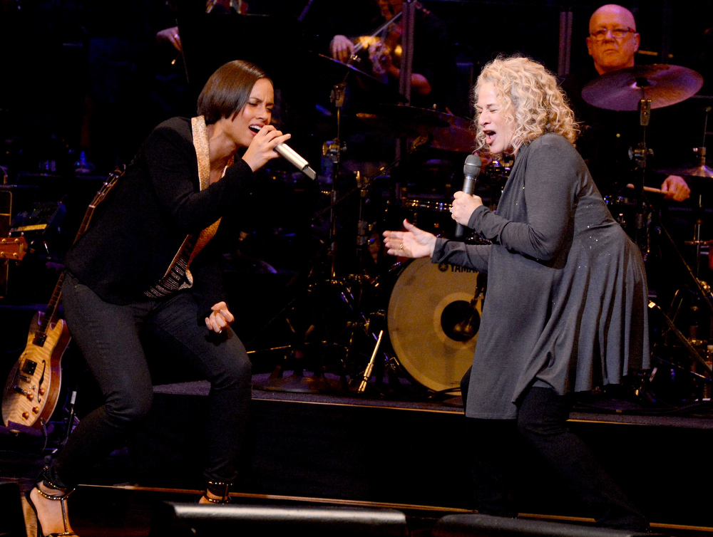 Description of . Singer Alicia Keys (L) and Singer/songwriter Carole King perform onstage during celebration of Carole King and her music to benefit Paul Newman's The Painted Turtle Camp at the Dolby Theatre on December 4, 2012 in Hollywood, California.  (Photo by Michael Buckner/Getty Images for The Painted Turtle Camp)