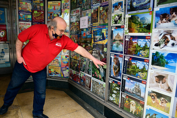 4/16/2020 Mike Orazzi | Staff Steve Amato of Amato's Toy and Hobby in downtown New Britain on Thursday is selling from the sidewalk.