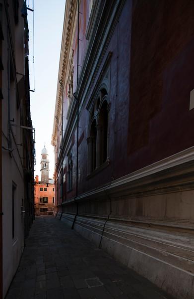 The bell tower of San Pantalon church at the end of a narrow sreet, Venice, Italy