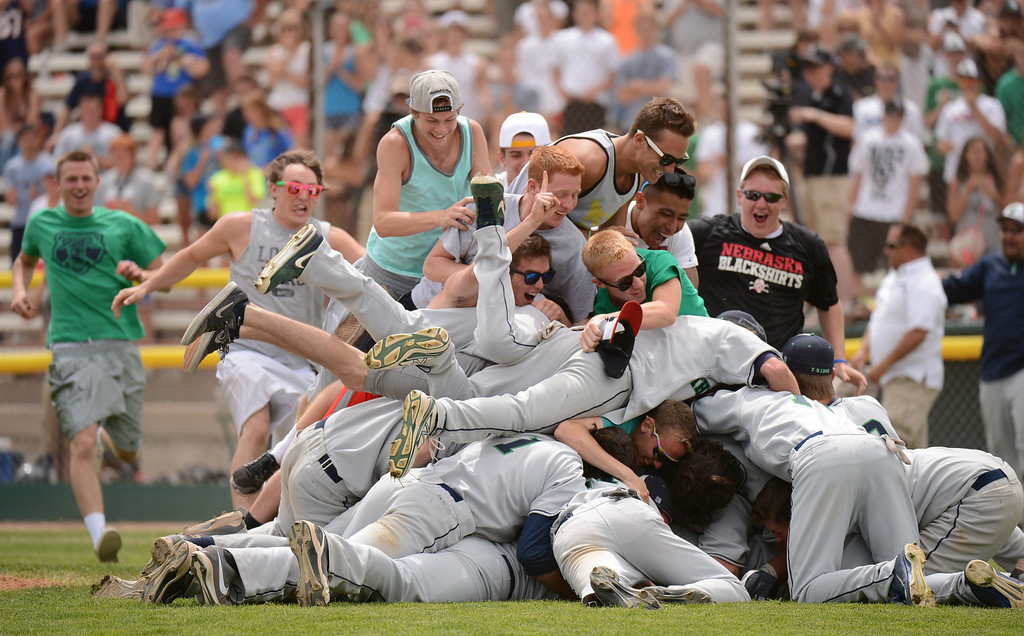 . DENVER, CO. - MAY 25: ThunderRidge HIgh School baseball team and students celebrate winning of 5A baseball state championship game against Rocky Mountain HIgh School at All City Field. Denver, Colorado. May 25, 2013. ThunderRidge won 2-1. (Photo By Hyoung Chang/The Denver Post)