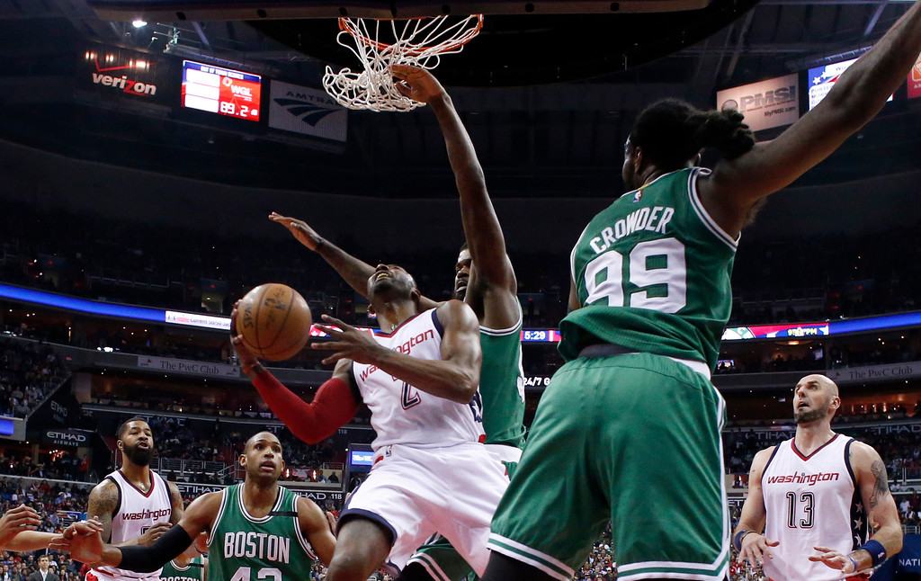 . Washington Wizards guard John Wall (2) shoots between Boston Celtics forward Amir Johnson, center right, and forward Jae Crowder, foreground right, during the second half of Game 6 of an NBA basketball second-round playoff series, Friday, May 12, 2017, in Washington. The Wizards won 92-91. (AP Photo/Alex Brandon)