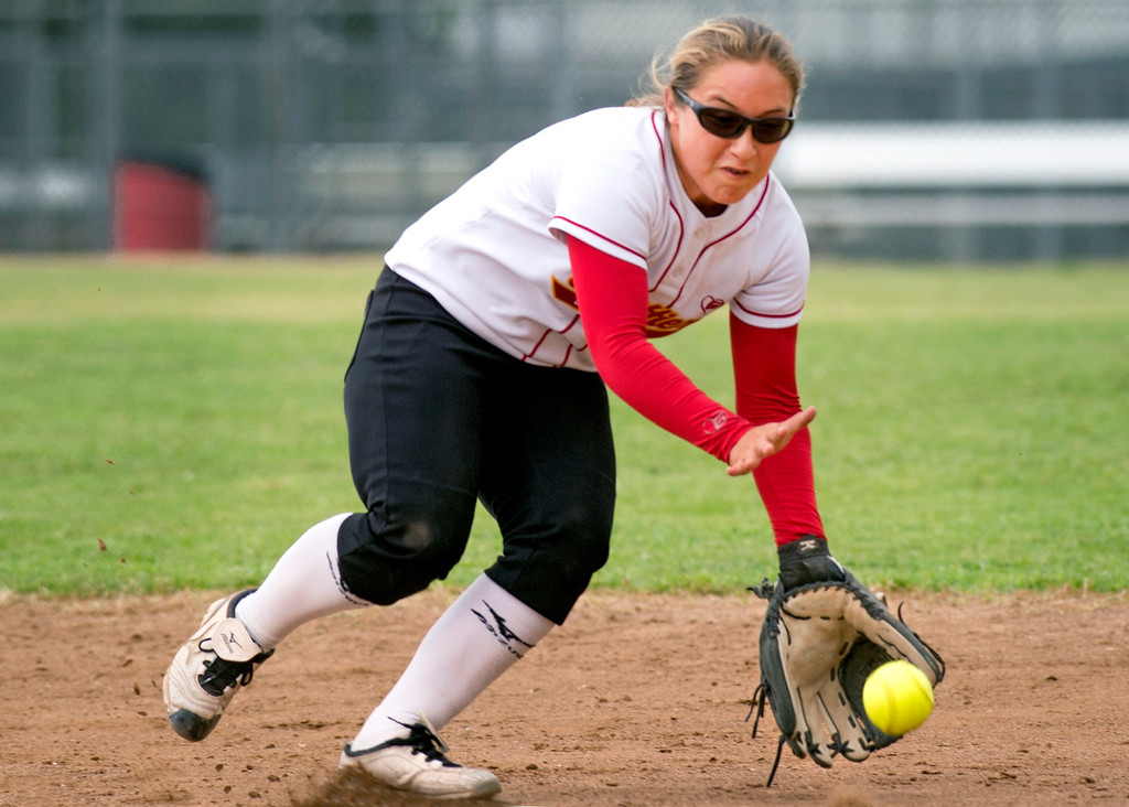 . Whittier Christian High 2B Erica Romo knocks down a grounder in the fourth inning vs La Serna High at La Serna\'s Whittier campus field March 25, 2014.  (Staff photo by Leo Jarzomb/Whittier Daily News)