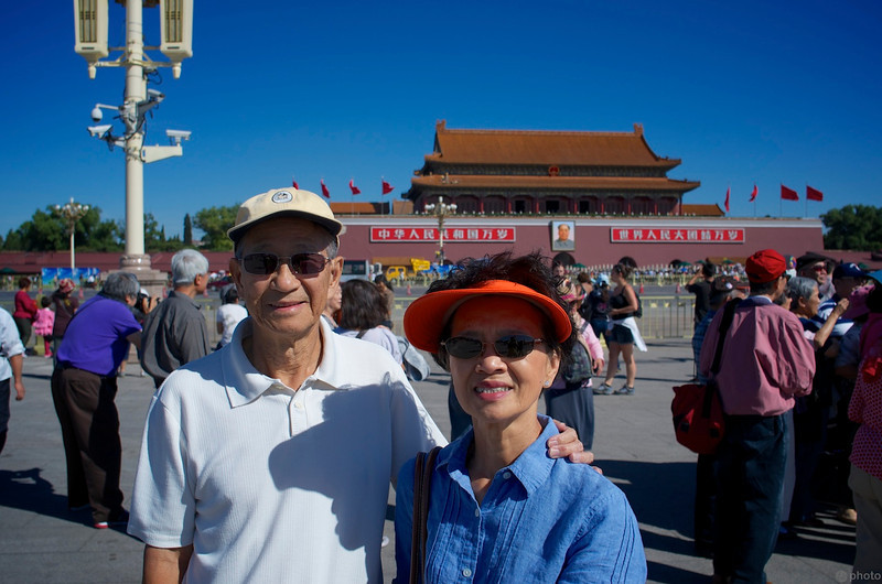 Mom and Dad across the street from the entrance to the Forbidden City
