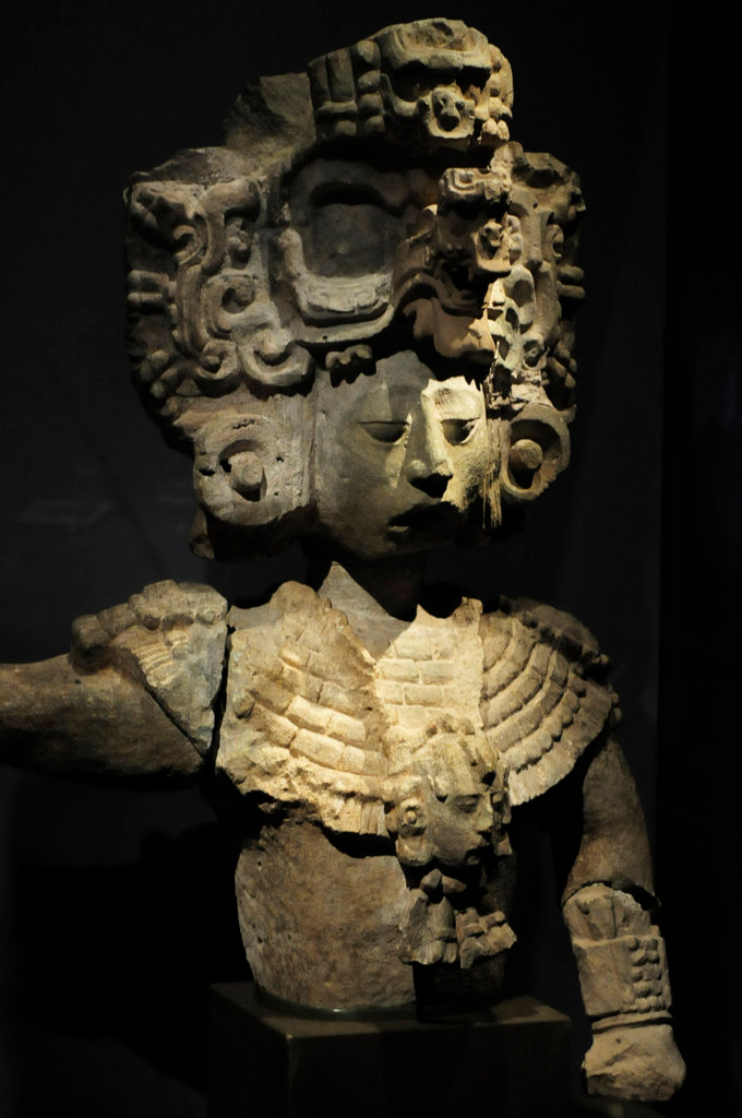 . A volcanic tuff stone statue of a King of Copan from the Classic Period: A.D. 725, from Temple 22 in Copan, Honduras. Discovered in the ruins of Temple 22 in Copan, this finely carved figure is probably a portrait of the kingdom\'s 13th ruler. The elaborate headdress features a mask of the Celestial Bird.  (Pioneer Press: Scott Takushi)