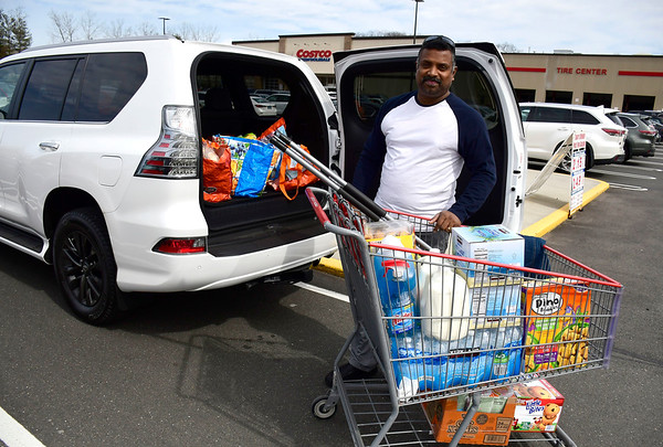 3/14/2020 Mike Orazzi | Staff Ram Solai while loading items he purchased at the Costco in New Britain on Saturday.