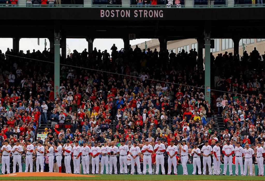 . Boston Red Sox players stand on the field during a pre-game ceremony honoring the victims of the Boston Marathon bombings, before the team\'s MLB American League baseball game against the Kansas City Royals at Fenway Park in Boston, Massachusetts April 20, 2013. REUTERS/Jessica Rinaldi