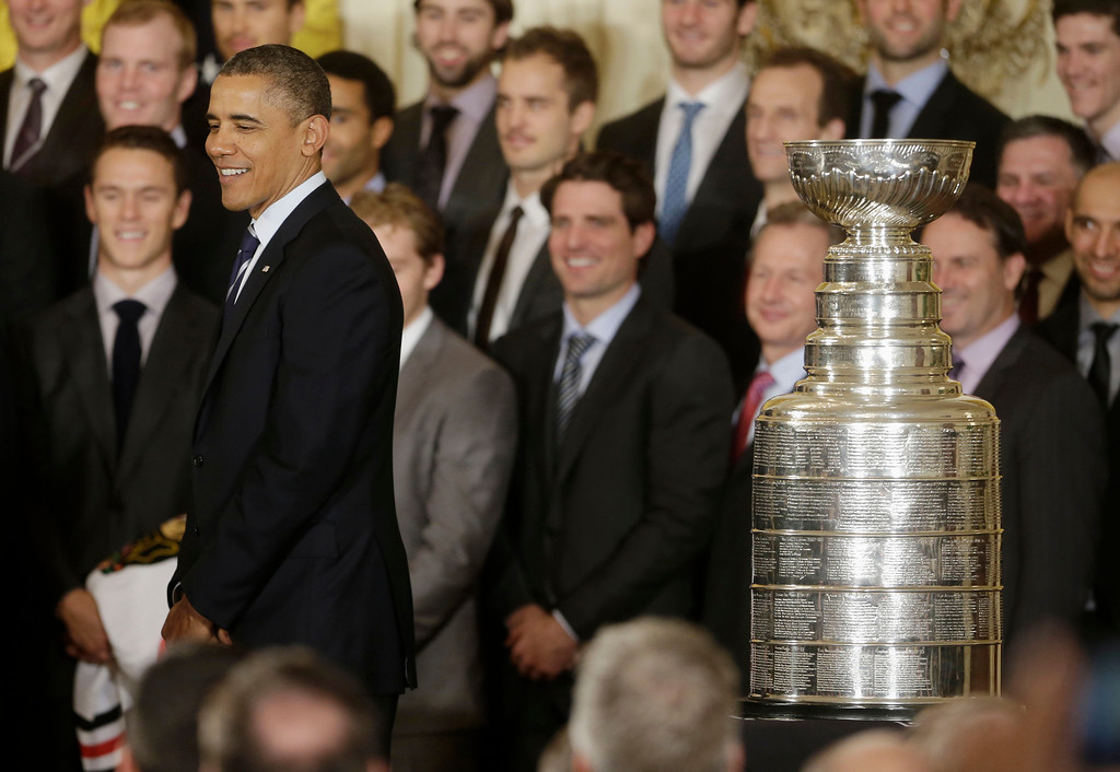 . President Barack Obama stands next to the Stanley Cup during a ceremony in the East Room of the White House in Washington, Monday, Nov. 4, 2013, where he honored the NHL 2013 Stanley Cup champion Chicago Blackhawks hockey team. (AP Photo/Pablo Martinez Monsivais)
