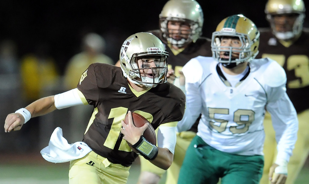 . St. Francis quarterback Ty Gangi (C) scrambles for a first down in the first half of a prep football game against Damien at St. Francis High School in La Canada, Calif., Friday, Sept. 27, 2013.   (Keith Birmingham Pasadena Star-News)