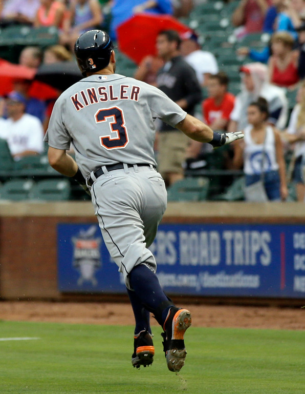 . Detroit Tigers\' Ian Kinsler (3) waves to the Texas Rangers dugout, not pictured, as he runs up the first base line after hitting a solo home run off of Rangers starter Colby Lewis in the first inning of a baseball game, Tuesday, June 24, 2014, in Arlington, Texas. The game is the first appearance by Kinsler in the ballpark since being traded to the Tigers for Prince Fielder. (AP Photo/Tony Gutierrez)