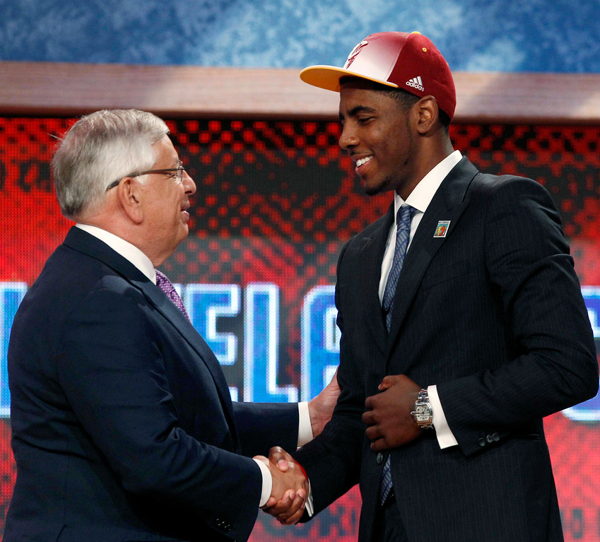 . NBA Commissioner David Stern, left, shakes hands with the No. 1 overall draft pick, Kyrie Irving, of Duke, who was selected by the Cleveland Cavaliers in the NBA basketball draft Thursday, June, 23, 2011, in Newark, N.J. (AP Photo/Mel Evans)