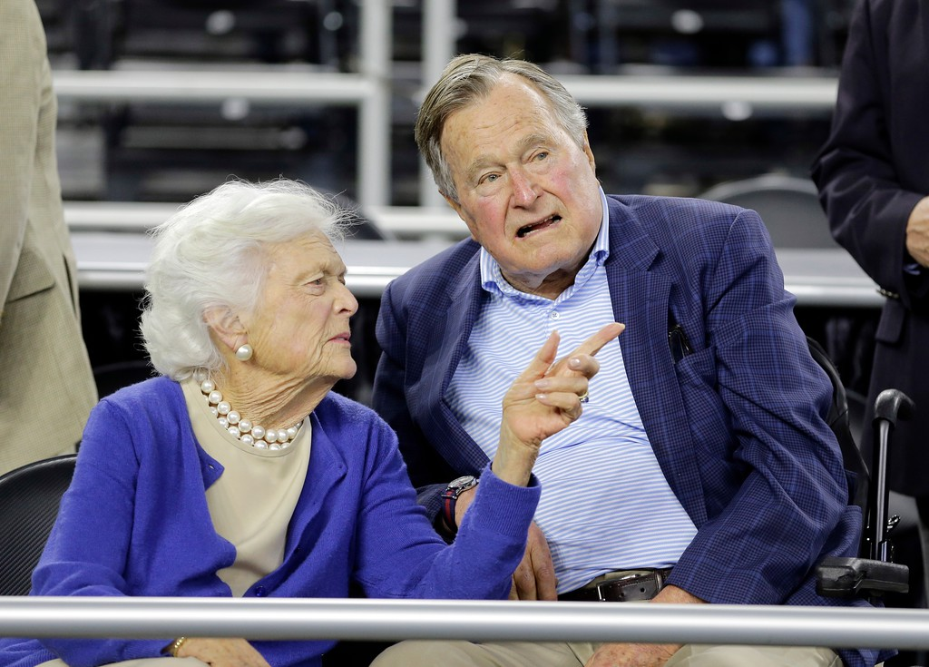 . Former President George H.W. Bush and his wife Barbara Bush speak before the first half of a college basketball regional final game between Gonzaga and Duke, in the NCAA Tournament Sunday, March 29, 2015, in Houston. (AP Photo/David J. Phillip)