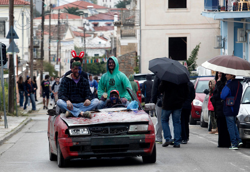". Revellers, atop a makeshift vehicle, celebrate ""Ash Monday\"" by participating in a colourful \""flour war\"", a traditional festivity marking the end of the carnival season and the start of the 40-day Lent period until the Orthodox Easter,in the port town of Galaxidi, some 215 km (134 miles) north west of Athens, March 18, 2013. The revellers \""fight\"" by throwing coloured flour, charcoal dust and powder painting until they essentially run out of supplies. REUTERS/Yannis Behrakis (GREECE - Tags: SOCIETY)"