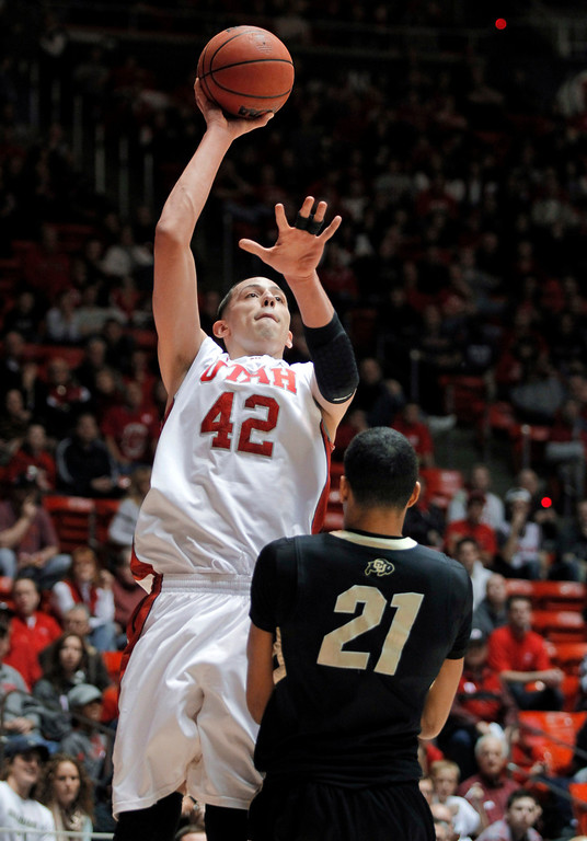 . Utah center Jason Washburn (42) puts a shot over Colorado forward Andre Roberson (21) during the first half of an NCAA college basketball game Saturday, Feb. 2, 2013, in Salt Lake City. (AP Photo/Steve C. Wilson)