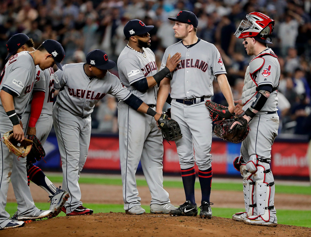 . Cleveland Indians pitcher Trevor Bauer, second from right, waits to be pulled from the game against the New York Yankees during the second inning in Game 4 of baseball\'s American League Division Series, Monday, Oct. 9, 2017, in New York. (AP Photo/Frank Franklin II)