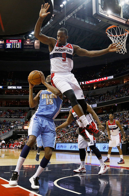 . WASHINGTON, DC - FEBRUARY 22: Martell Webster #9 of the Washington Wizards fouls Corey Brewer #13 of the Denver Nuggets during the first half at Verizon Center on February 22, 2013 in Washington, DC. (Photo by Rob Carr/Getty Images)