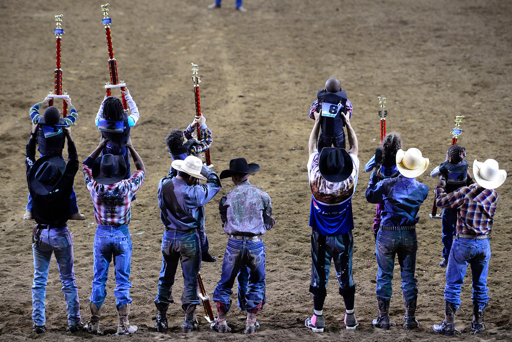 . DENVER, CO. - JANUARY 21:  Cowboys lift the mutton busters after they received their trophies at the National Western Stock Show Martin Luther King Heritage Rodeo January 21, 2013 (Photo By AAron Ontiveroz / The Denver Post)