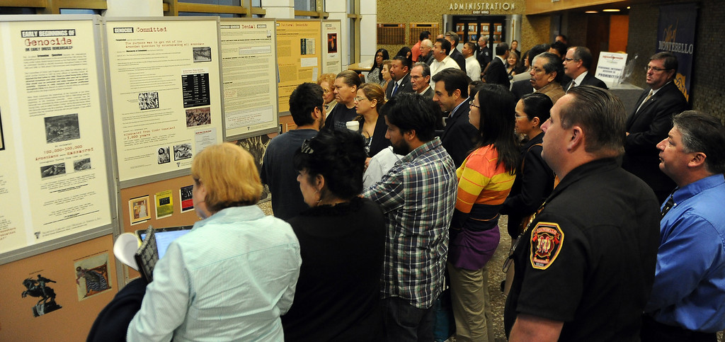 . Locals look over a traveling Armenian Genocide display at the Montebello City Hall on Wednesday, April 10, 2012 in Montebello, Calif. It is the 98th anniversary of the genocide, which occurred between 1915-1923.   (Keith Birmingham/Pasadena Star-News)