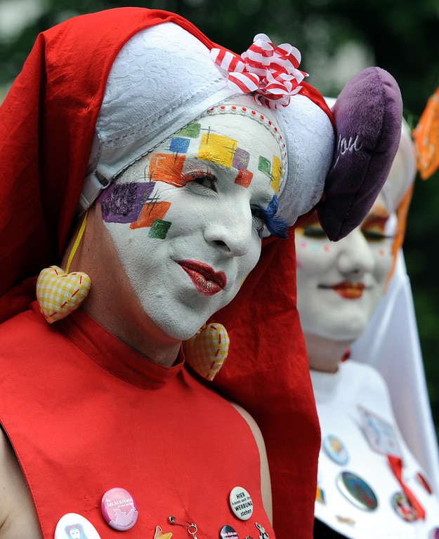 . Masked participants  take part in  a Christopher Street Day parade in Oldenburg, northern Germany, Saturday June 15, 2013.   (AP Photo/dpa, Ingo Wagner)