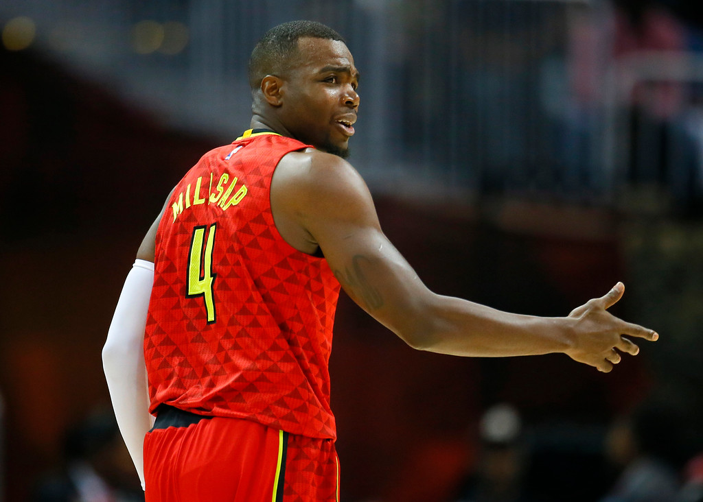 . Atlanta Hawks forward Paul Millsap (4) reacts in the first half of an NBA basketball game against the Cleveland Cavaliers on Sunday, April 9, 2017, in Atlanta. The Hawks won in overtime 126-125. (AP Photo/Todd Kirkland)