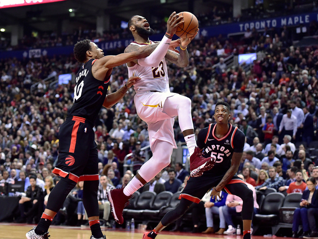 . Toronto Raptors guard DeMar DeRozan (10) fouls Cleveland Cavaliers forward LeBron James (23) as he goes to the net during the second half of an NBA basketball game Thursday, Jan. 11, 2018, in Toronto. (Frank Gunn/The Canadian Press via AP)