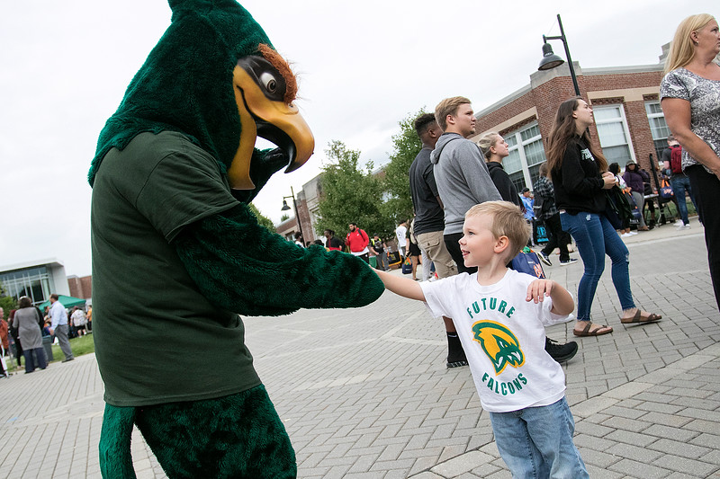 The annual Fitchburg State University Rock the Block is an event to showcase student clubs and campus organizations along with some off campus local jobs students could apply for for extra money. FSU's Freddie the Falcon fist bumps future student Keegan Croteau at the Rock the Block. His mom works at the University. SENTINEL & ENTERPRISE/JOHN LOVE